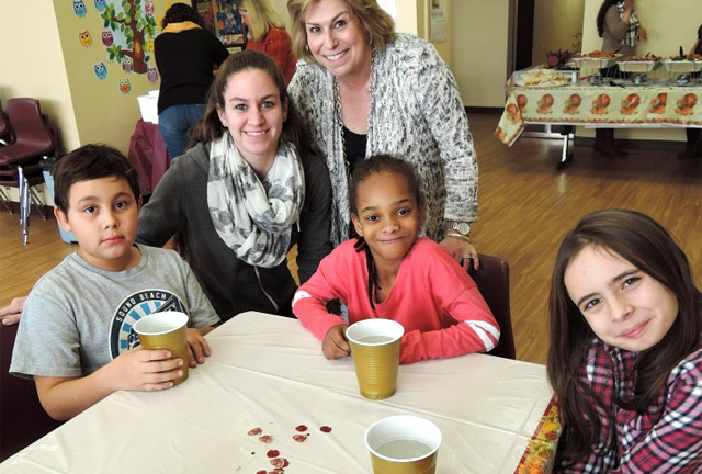 Executive Director Viviana Litovsky and students at Thanksgiving Celebration