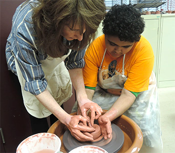 Teacher and student working at potters wheel - Special Education, Bloomfield NJ
