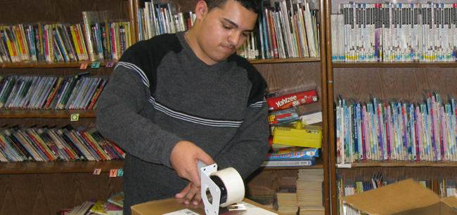 Student packing books at Westbridge Academy, Bloomfield NJ