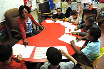 Teacher with students in group instruction - Special Education Bloomfiled NJ