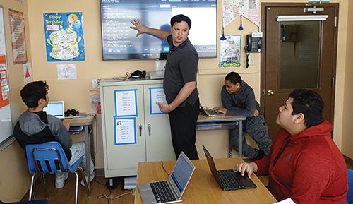 Teacher Matt Dango working with students to learn coding - Westbridge Academy